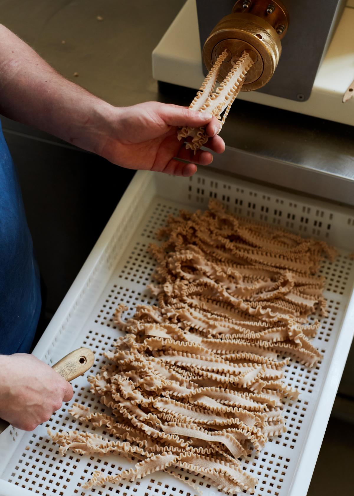 Harry making pasta